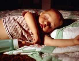 Child sleeping with bottle at Piedmont Pediatric Dentistry in Charlottesville, Waynesboro and Crozet, VA