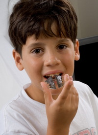 Boy with retainer at Piedmont Pediatric Dentistry in Charlottesville, Waynesboro and Crozet, VA