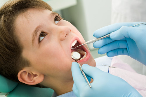 Boy during dental exam at Piedmont Pediatric Dentistry in Charlottesville, Waynesboro and Crozet, VA