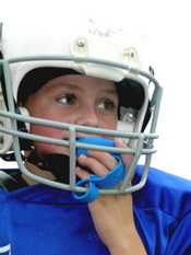 Child in sports helmet wearing mouthguard at Piedmont Pediatric Dentistry in Charlottesville, Waynesboro and Crozet, VA